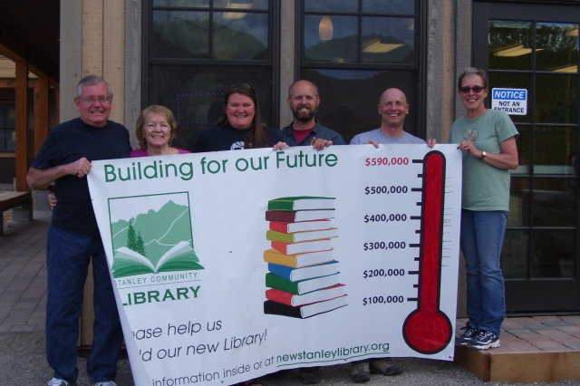 Trustees Dave Lesser, Lynne Hutchins, Sylvia Hamilton, Doug Plass and Phil Coonts, with Library Director Jane Somerville, show off the library's fundraising thermometer. Photo by Aron Ames.